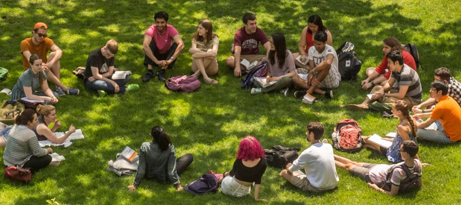 UChicago undergrads meet for class on the main Quad on a beautiful day.