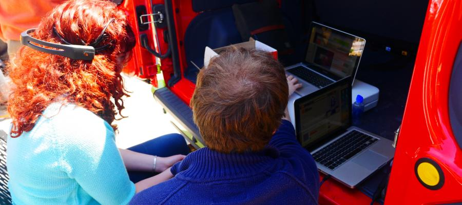 Students use brain waves to control a laptop as part of Think Tank's mobile learning unit.